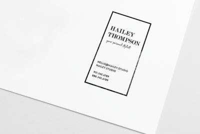 rubber business card stamp in vertical, contemporary stylish design stamped on paper