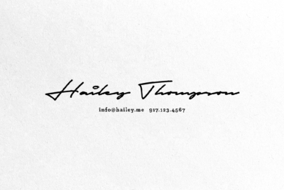 handwriting script signature stamped on paper